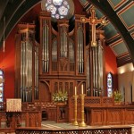 Caption: The chancel view of the suspended cross, full organ case , choir, high altar with reredos. (Source: St. Paul's Episcopal Church, www.stpaulsindy.org)