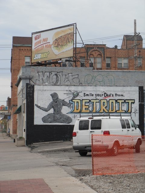 Because public art can tow the party line american dirt for Motor city towing detroit
