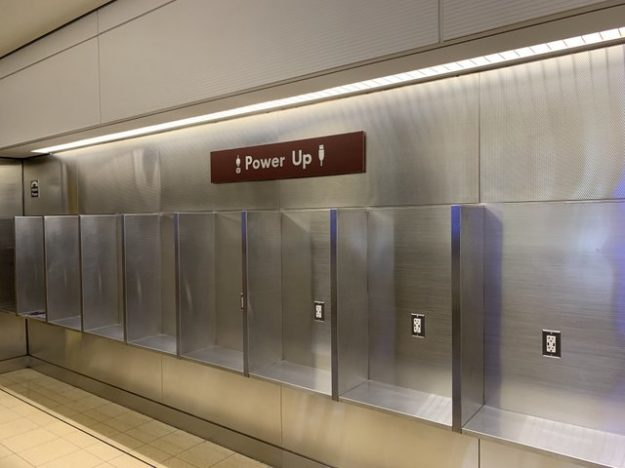 charging stations at old pay phones in DCA