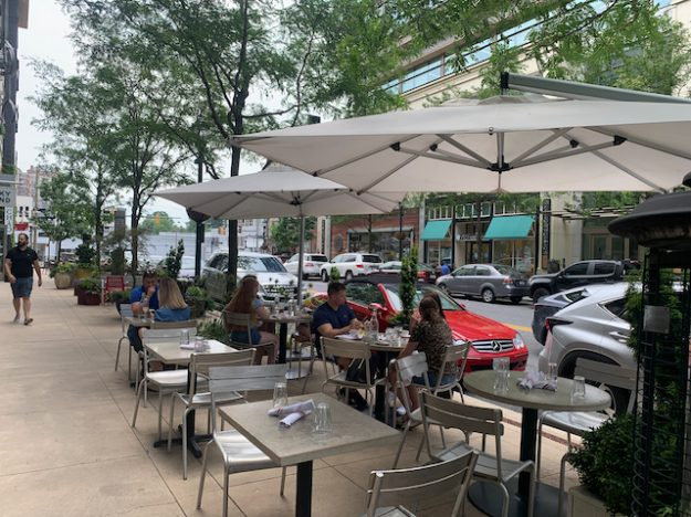 Café scene in a mixed-use town center called Pike and Rose