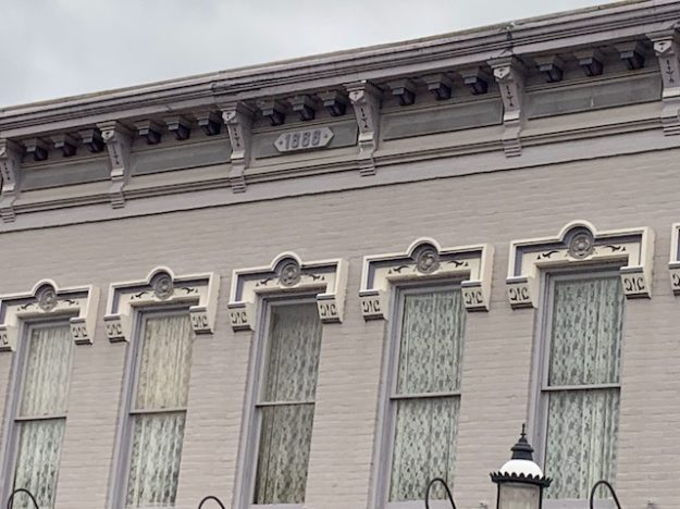 construction year at the cornice in a Harrison OH main street building