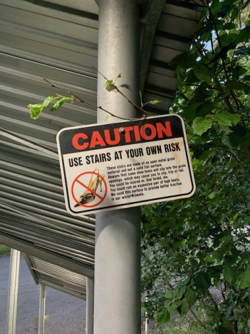 staircase with warning signs