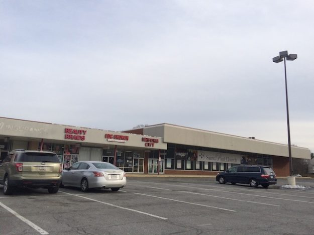red-letter signage in aging strip mall, Maryland